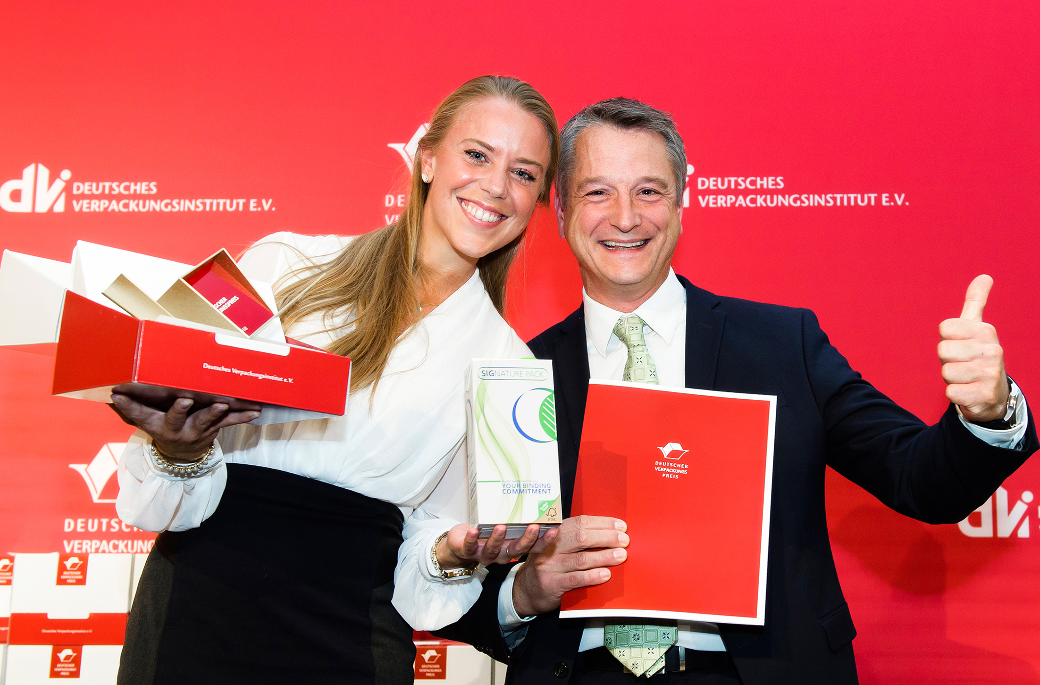 Nora Wigand, Marketing Account Manager D-A-CH, and Udo Felten, Manager Product Related Global Environmental Sustainability & Affairs at SIG, have received the German Packaging Award on behalf of SIG at the award ceremony in Nuremberg. Picture: Uwe Niklas