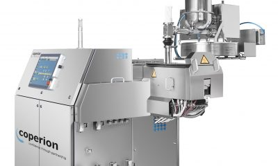 Coperion's ZSK 18 Megalab twin screw extruder with Coperion K-Tron gravimetric loss-in-weight feeder, suitable for research and development as well as for small-scale production.